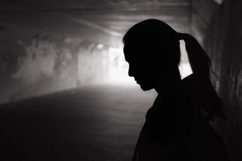 Depressed,Sad,Young,Female,Standing,In,A,Dark,Tunnel